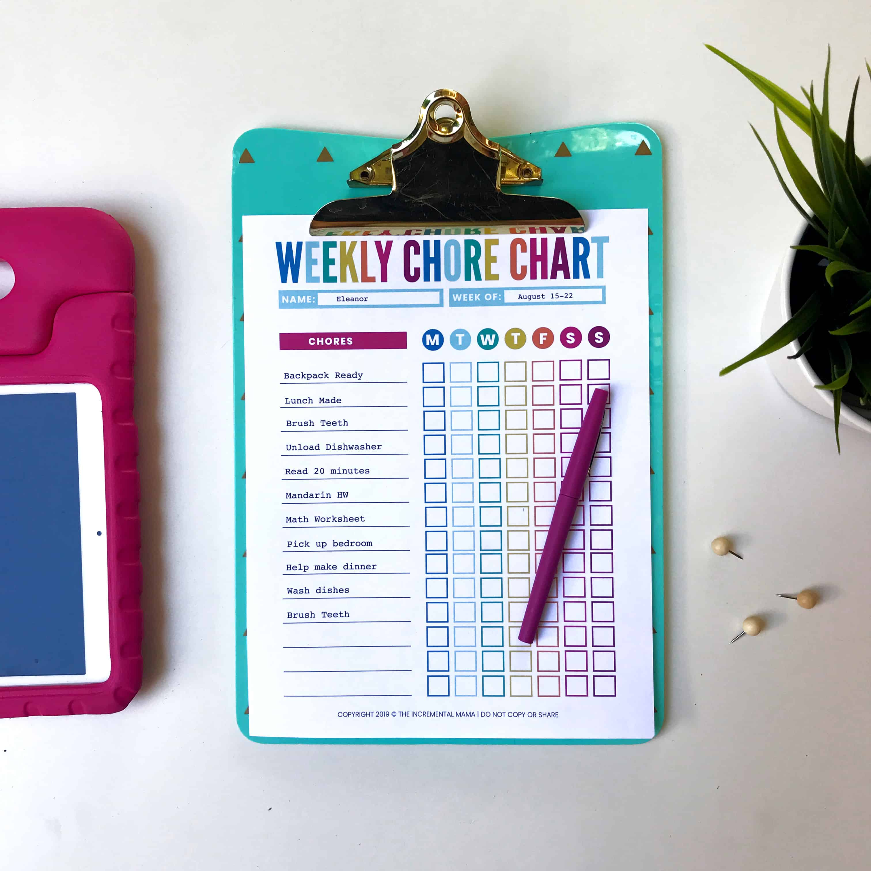 colorful editable chore chart on desk