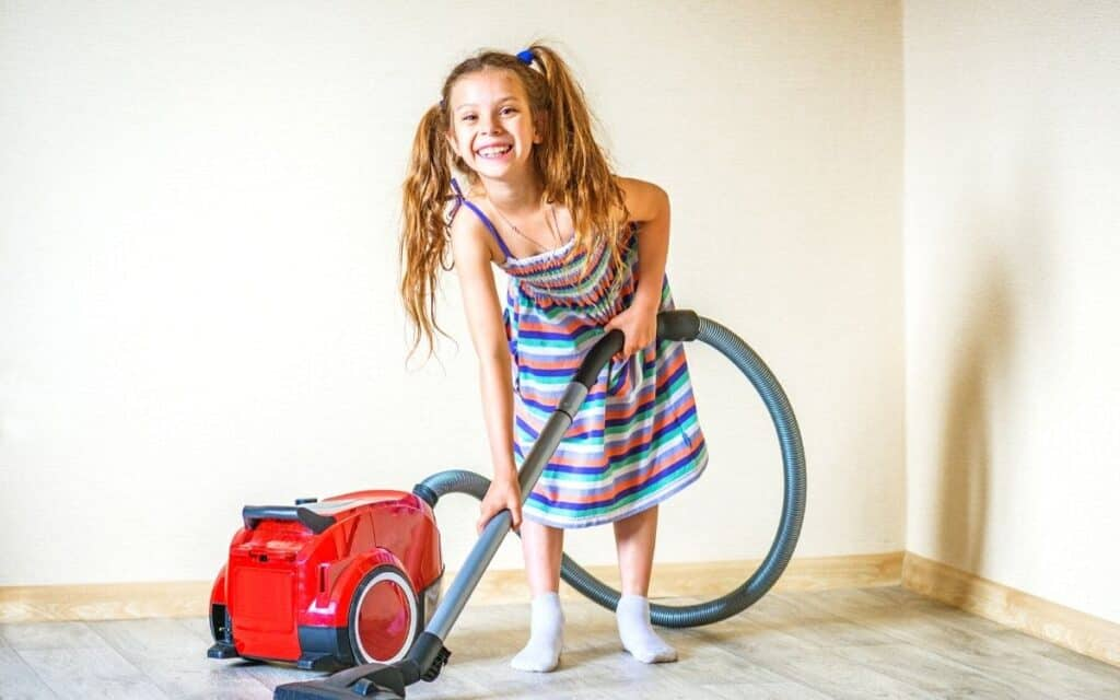 happy kid doing chores