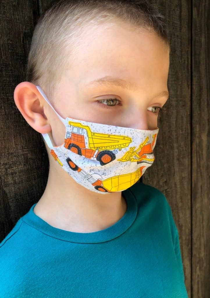 kid in mask with trucks on it