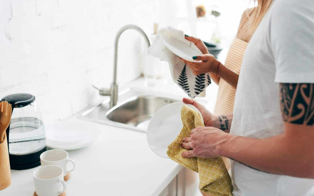 washing dishes to keep home clean